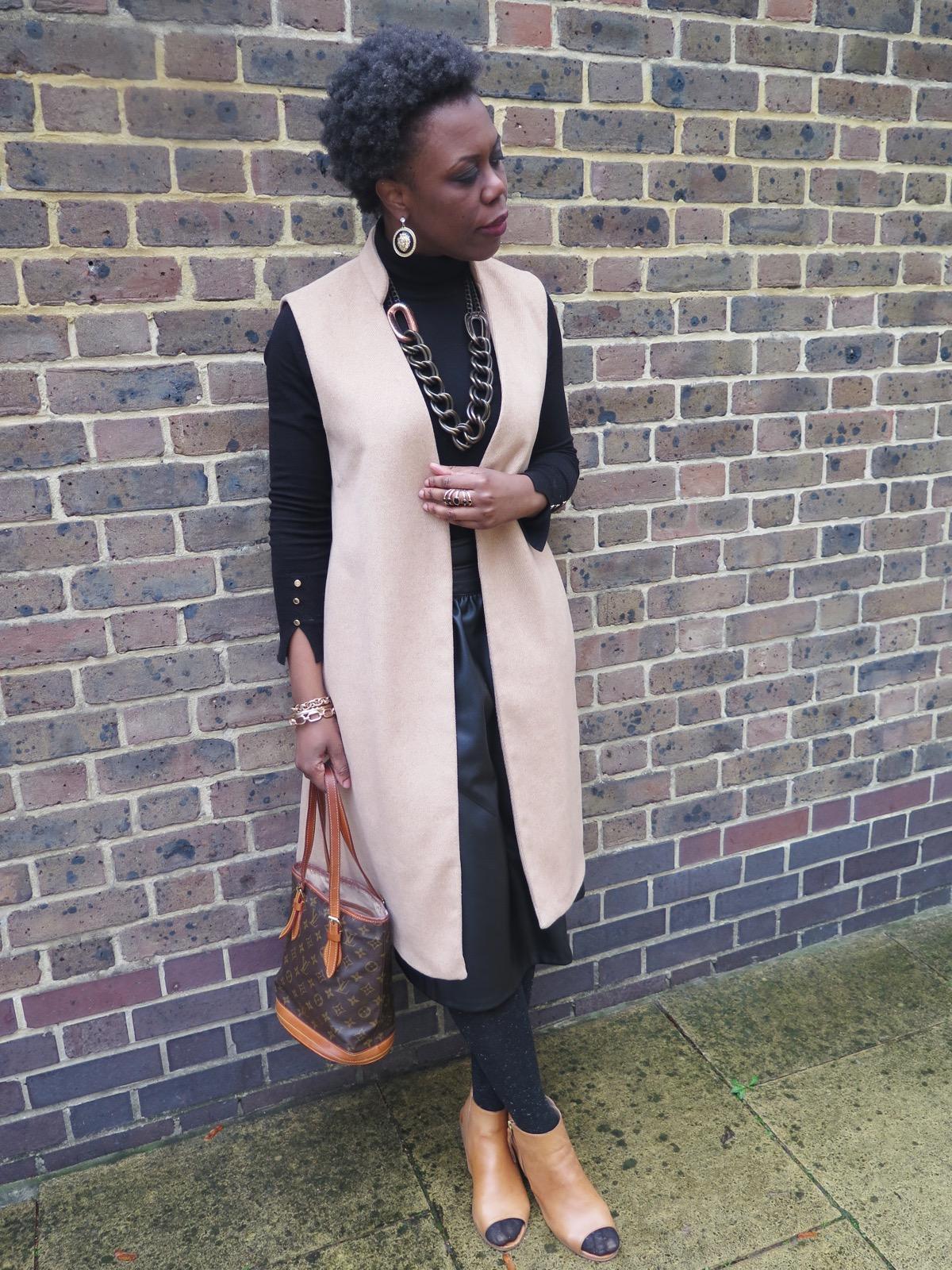 sleeveless long camel coat