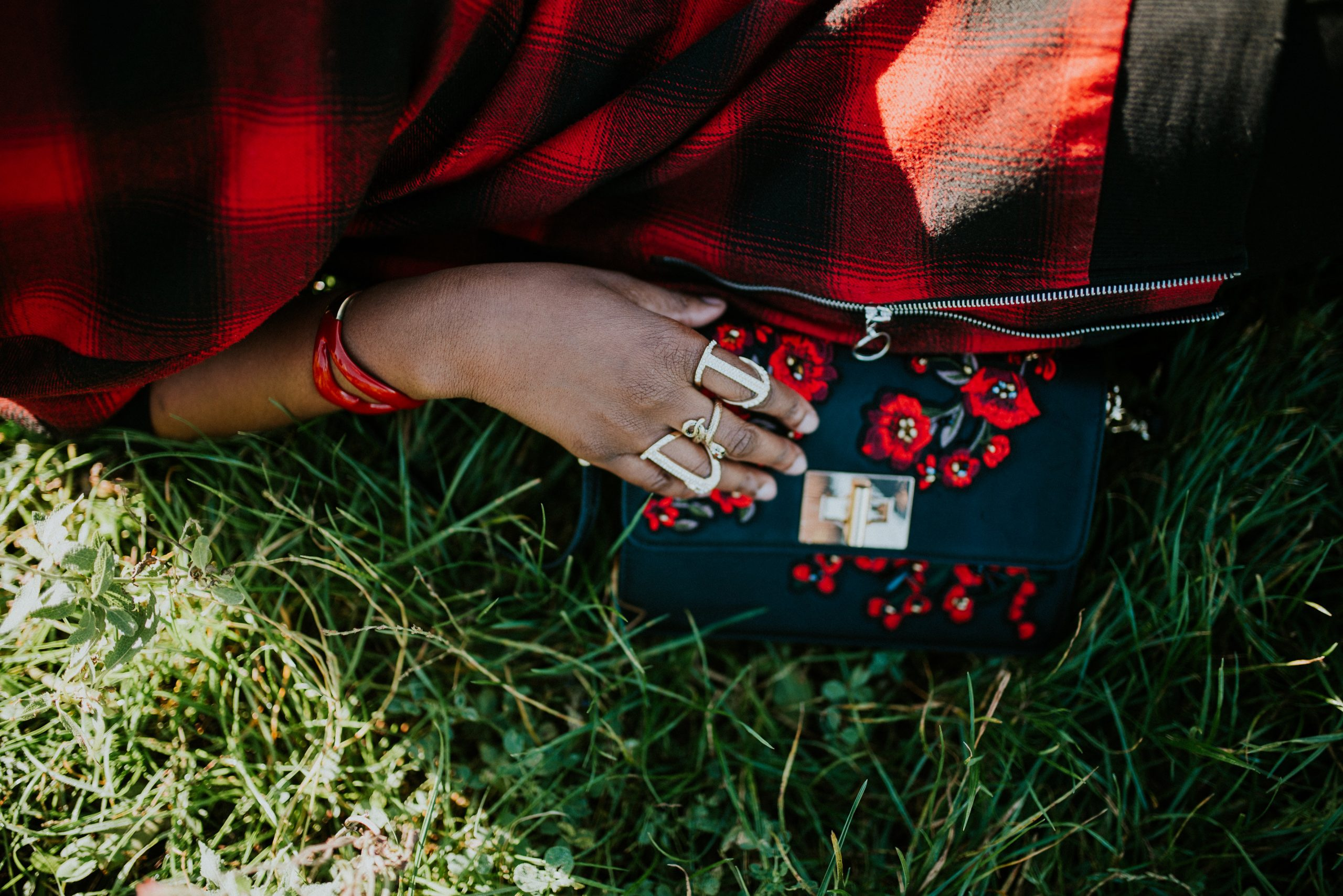black and red embroided bag