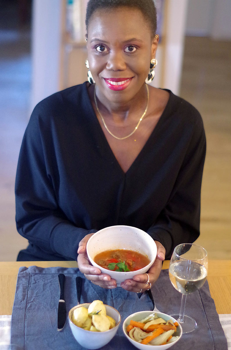 woman holding soup in bowl