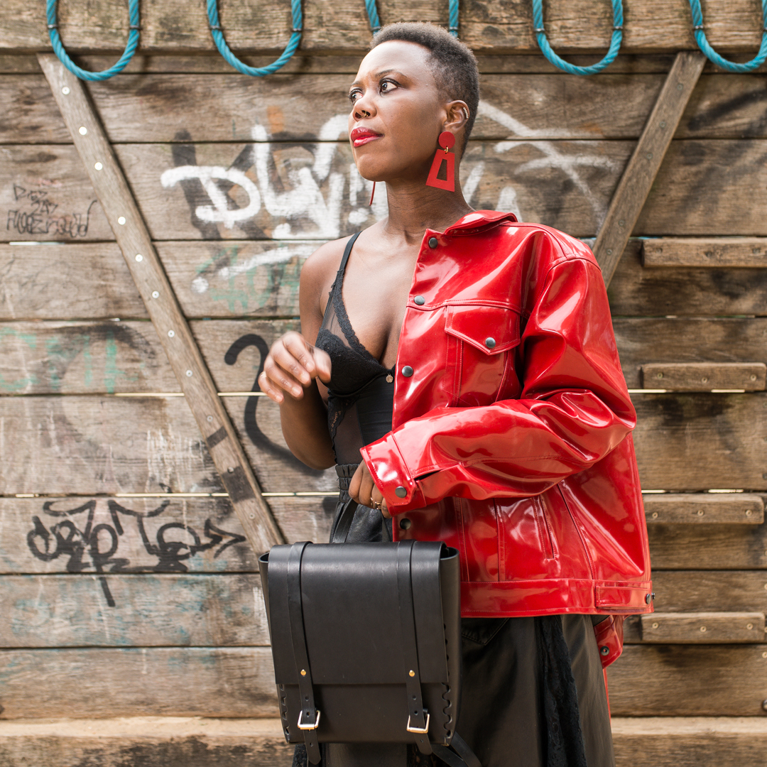 Red wet leather jacket by FAAM Studio and rucksack by LAMA