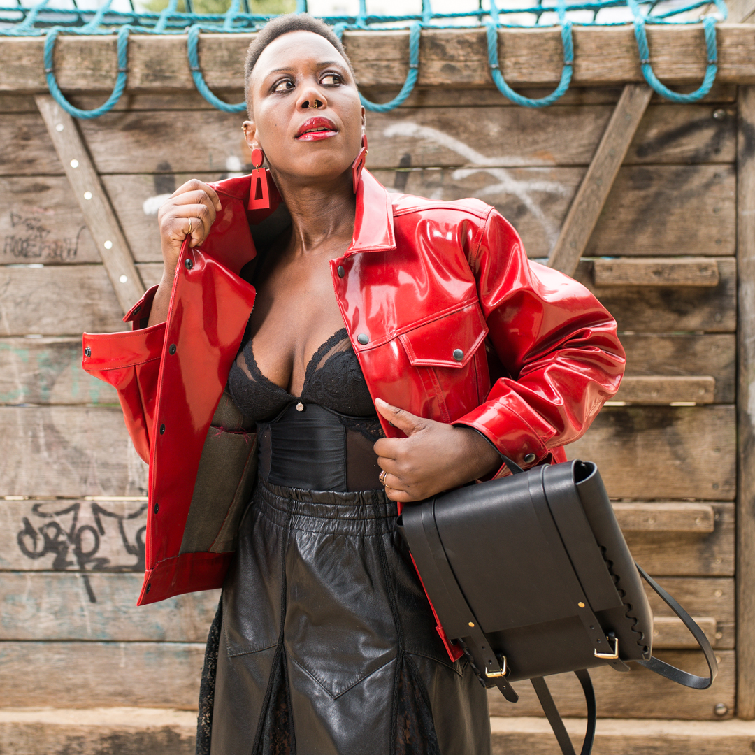Red jacket by Faam and rucksack by LAMA