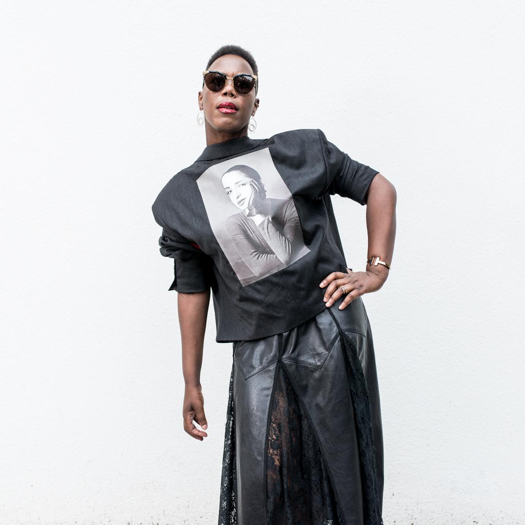 Black girl wearing Gucci sunglasses